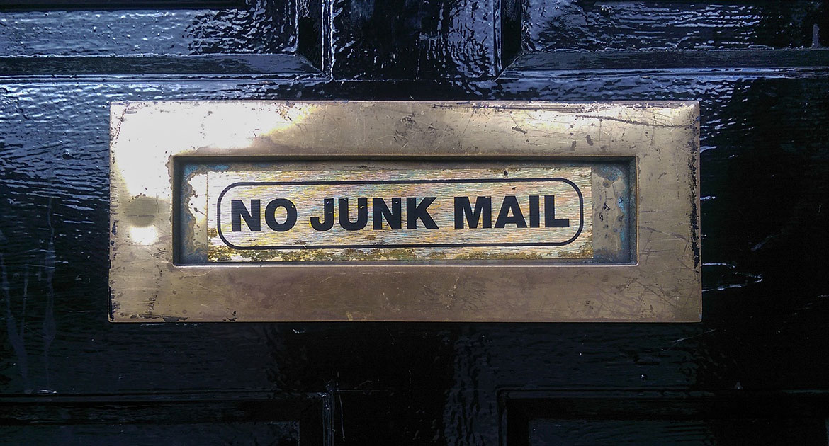 Mail Slot with No Junk Mail written on it