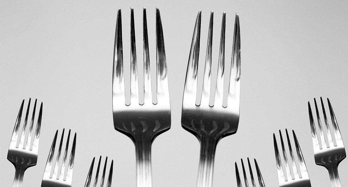 Multiple fork utensils arranged neatly