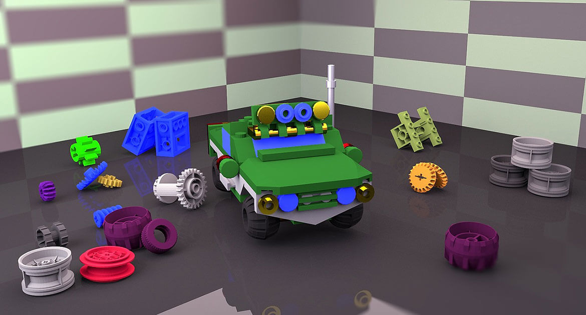 Building block car with extra pieces nearby
