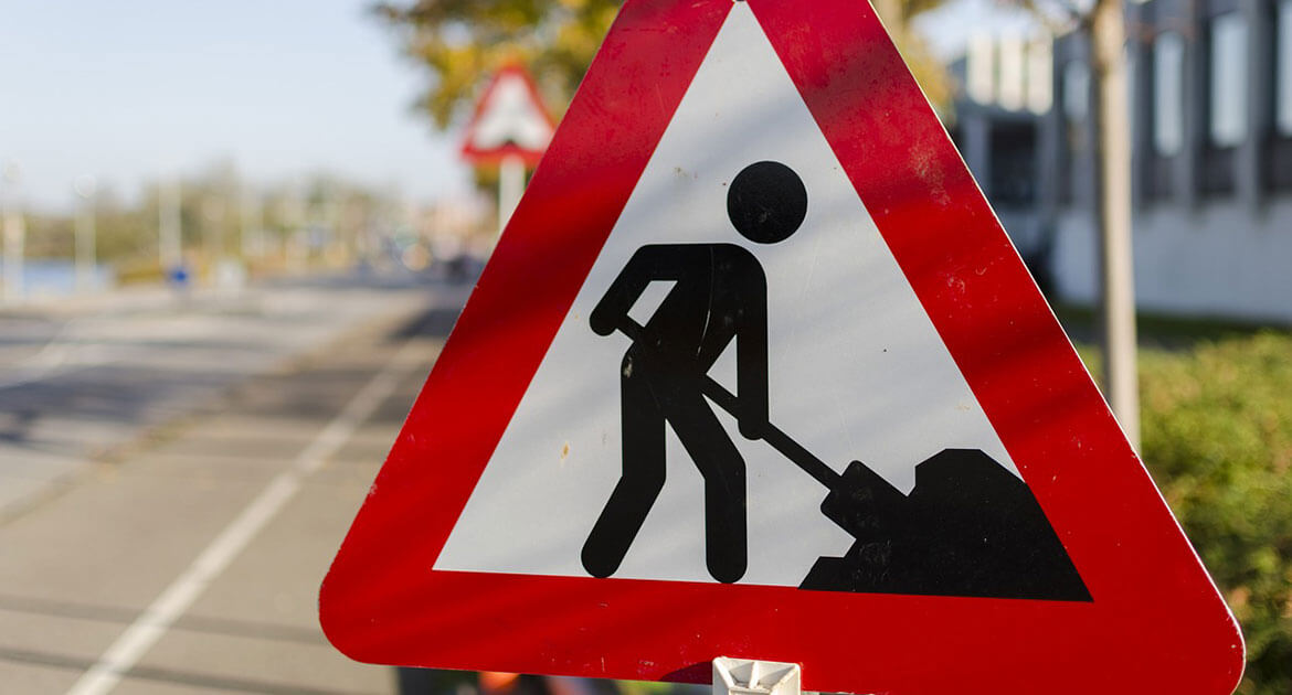 Road Construction Sign Showing Stick Figure Working with Shovel.