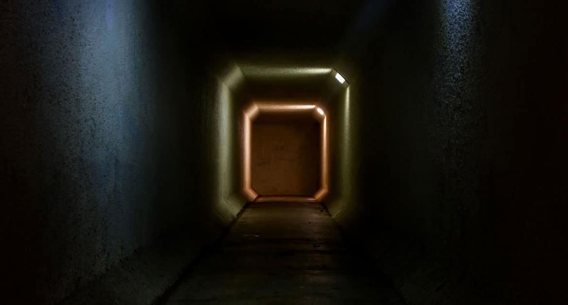 Photograph of a spooky dark tunnel.